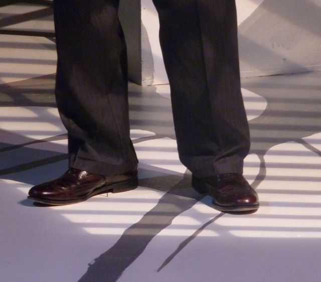 An actor's feet on stage