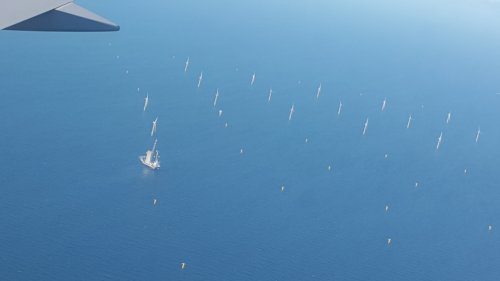 Windfarm and drilling platform in North Sea