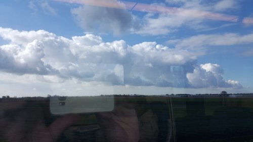 A train of clouds viewed from the train